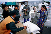 On winter days, the unheated market is cold, but the flour wholesalers, who work from trucks and sheds outside the market, are even colder. Ulaanbaatar, Mongolia. Hungry Planet: What the World Eats (p. 230). This image is featured alongside the Batsuuri family images in Hungry Planet: What the World Eats.