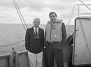 Round Europe Yacht Race.   (R61)..1987..25.07.1987..07.25.1987..25th July 1987..President Patrick Hillery started the Round Europe Yacht Race which began at Dun Laoghaire today...Posing for the cameras are Mr Mr Freddie Cooney, Coiste an Asgard ll, and Commissioner Peter Sutherland.