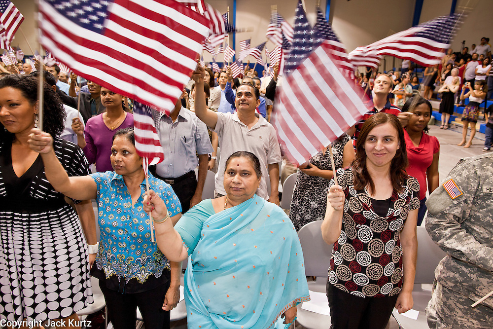 """July 2 - PHOENIX, AZ: RAMILABEN GORDHUNBHUI PATEL, originally from India, and others are sworn in as new US citizens Friday. Nearly 200 people were sworn in as US citizens during the """"Fiesta of Independence"""" at South Mountain Community College in Phoenix, AZ, Friday. The ceremony is an annual event on th 4th of July weekend and usually the largest naturalization ceremony of the year in the Phoenix area.  Photo by Jack Kurtz"""