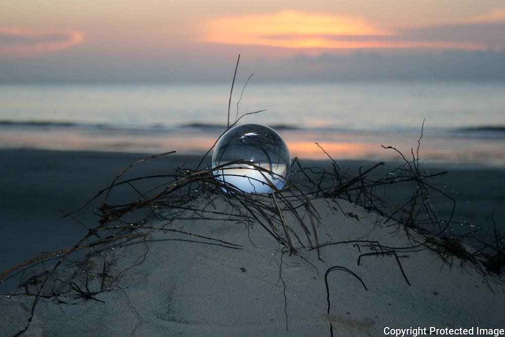crystal ball at sunrise on dune on Jekyll Island beach