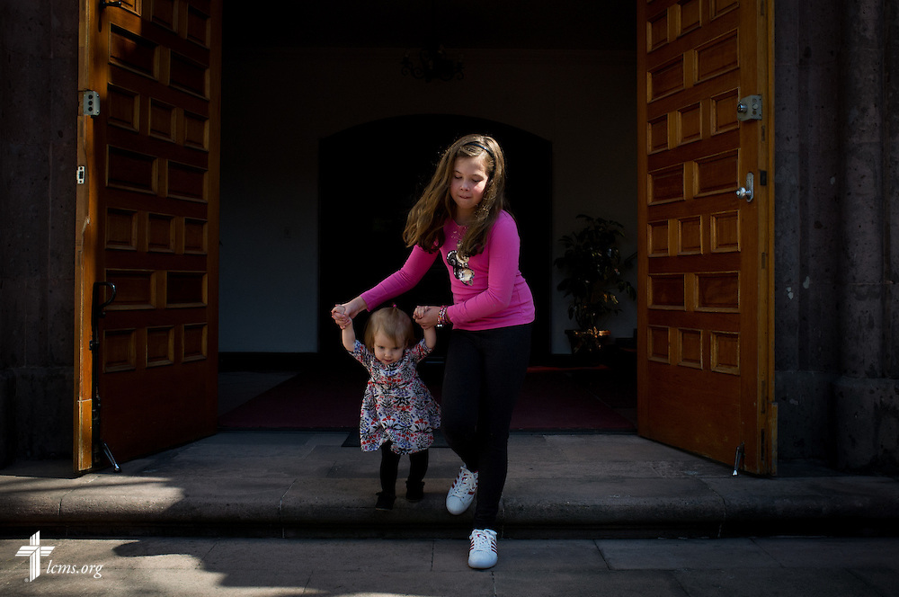 Camila Potter leads Charlotte Schlund out the door following worship and fellowship at the Lutheran Church of The Good Shepherd on Sunday, Jan. 15, 2017, in Mexico City. LCMS Communications/Erik M. Lunsford