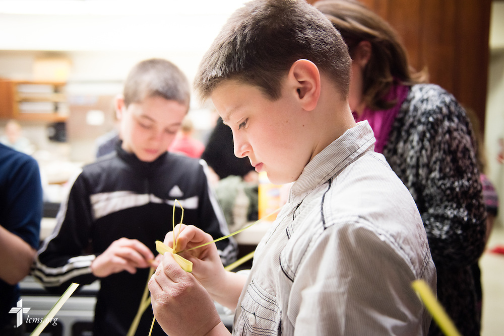 Children make crosses from palm fronds during a hands-on activity at Brookfield Lutheran Church on Sunday, March 29, 2015, in Brookfield, Wis. LCMS Communications/Erik M. Lunsford