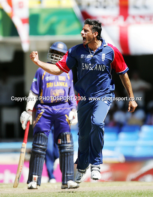 England bowler Sajid Mahmood celebrates taking the wicket of Sanath Jayasuriya during the Super 8 Cricket World Cup match, England v Sri Lanka at the Sir Vivian Richards Cricket Ground in Antigua, West Indies on Wednesday 4 April 2007. &quot;NO AGENTS&quot; Photo: Andrew Cornaga/Photosport.<br /> <br /> <br /> 040407