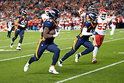 Denver Broncos rookie wide receiver Courtland Sutton (14) blocks as Denver Broncos rookie running back Royce Freeman (28) runs for a 14 yard touchdown that ties the second quarter score at 10-10 during the NFL week 4 regular season football game against the Kansas City Chiefs on Monday, Oct. 1, 2018 in Denver. The Chiefs won the game 27-23. (©Paul Anthony Spinelli)