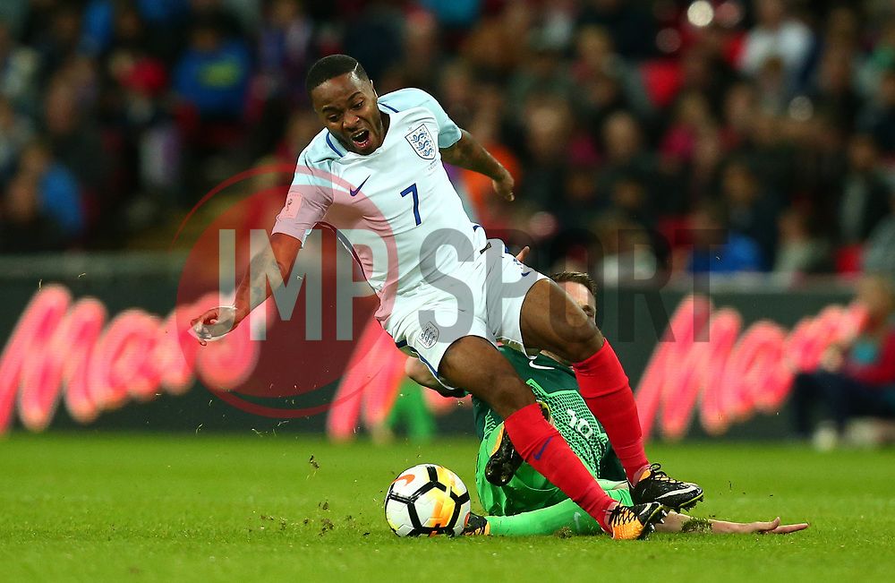 Raheem Sterling of England is fouled by Rajko Rotman of Slovenia - Mandatory by-line: Robbie Stephenson/JMP - 05/10/2017 - FOOTBALL - Wembley Stadium - London, United Kingdom - England v Slovenia - World Cup qualifier