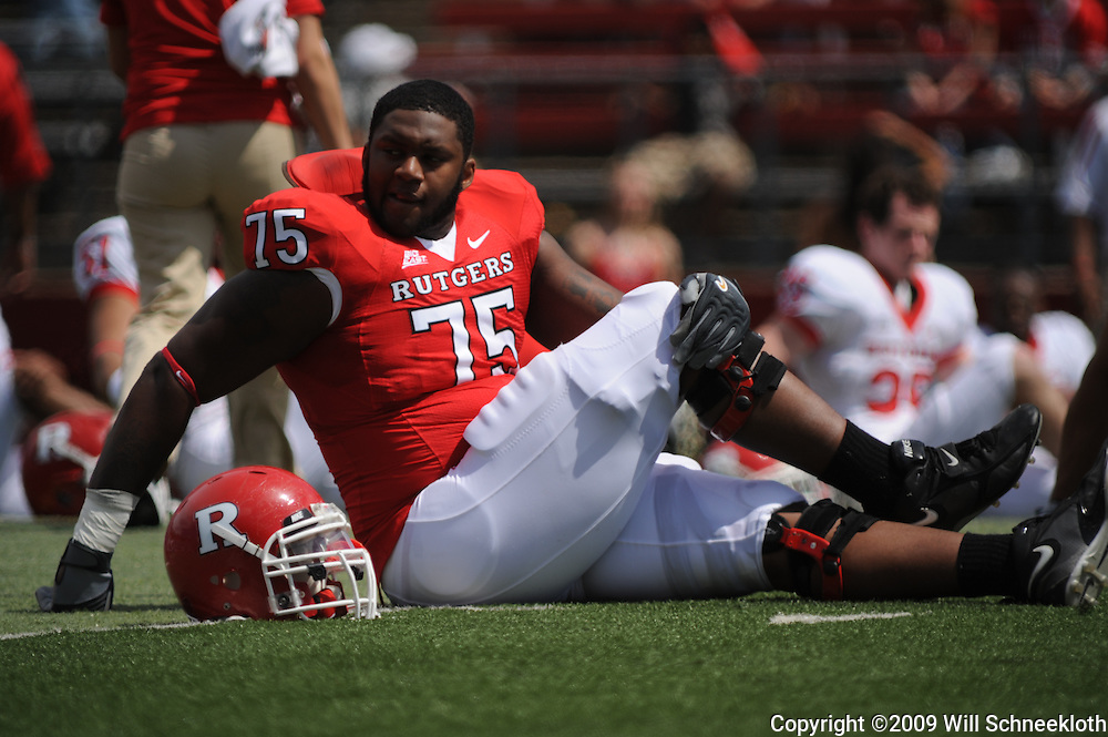 Apr 18, 2009; Piscataway, NJ, USA; Rutgers OL Anthony Davis (75) stretches prior to Rutgers' Scarlet and White spring football scrimmage.