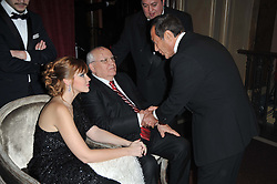 Left to right, KSENIA GORBACHEVA, MIKHAIL GORBACHEV and PAUL ANKA at a gala eveing to celebrate the 80th birthday of former Soviet leader Mikhail Gorbachev held at The Royal Albert Hall, London on 30th March 2011.
