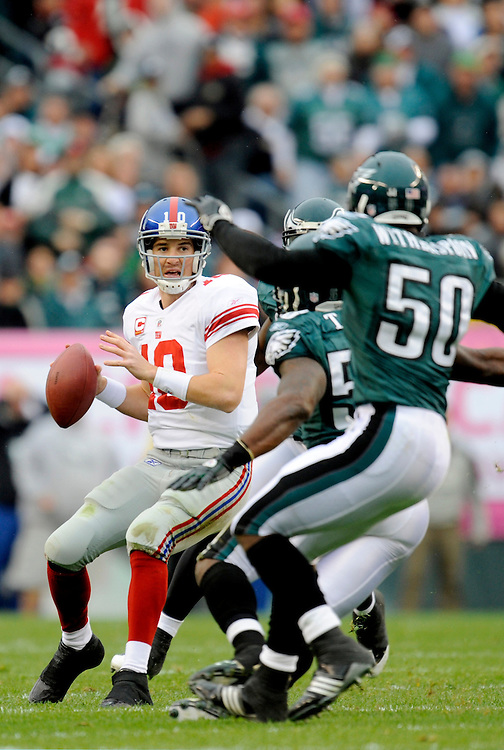 PHILADELPHIA - NOVEMBER 01: Eli Manning #10 of the New York Giants drops back to pass against the Philadelphia Eagles on November 1, 2009 at Lincoln Financial Field in Philadelphia, Pennsylvania. The Eagles defeated the Giants 40 to 17(Photo by Rob Tringali) *** Local Caption *** Eli Manning