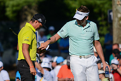 August 9, 2018 - Town And Country, Missouri, U.S - IAN POULTER from England jokes with RICKIE FOWLER from Murrieta California, USA  about his sweat outline developing on his shirt during round one of the 100th PGA Championship on Thursday, August 8, 2018, held at Bellerive Country Club in Town and Country, MO (Photo credit Richard Ulreich / ZUMA Press) (Credit Image: © Richard Ulreich via ZUMA Wire)