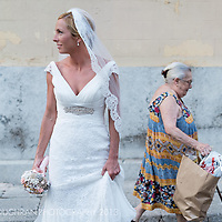 After her weddingn the bride waits for the groom on the streets of Sitges, Barcelona, Spain.