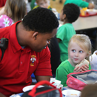 Adam Robison | BUY AT PHOTOS.DJOURNAL.COM<br /> Sidney Jones, a firefighter with the Tupelo Fire Department, shares a conversation with Paisley Ellis, 4, a student at ECEC during lunch on Friday. The Tupelo Fire Department has started a new program. The firemen on shift go eat lunch at lower elementary schools to give kids a chance to see firemen are their friends.