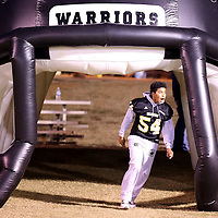Adam Robison | BUY AT PHOTOS.DJOURNAL.COM<br /> Jay Whitfield, a freshman at Pontotoc High School, runs through the inflatable helmet tunnel to join his JV teammates on the sideline before the start of the Pontotoc vs Shannon game Friday night in Pontotoc.