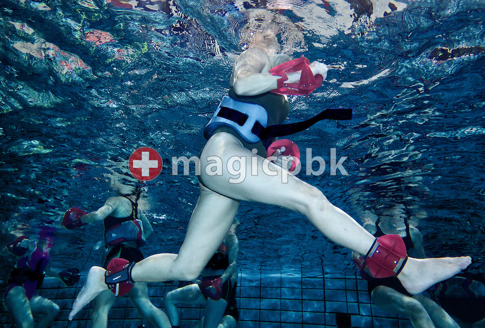 Participants using Speedo's Hydro Resistant Arm and Leg Trainers and Speedo's Hydro Belt are pictured during an Aqua Fitness lesson during the 1st Speedo Aqua-Fit Convention held in Affoltern, Switzerland, Saturday, Sept. 3, 2011. (Photo by Patrick B. Kraemer / MAGICPBK)