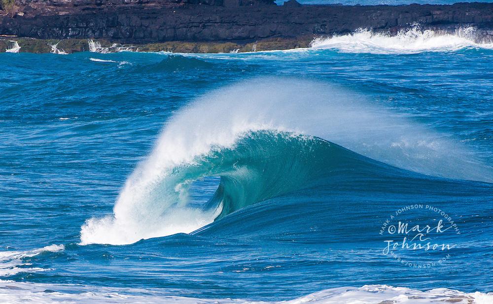 Powerful wave breaking off a Kauai, Hawaii beach