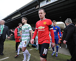 Manchester United's Wayne Rooney and Yeovil Town's Joe Edwards lead their teams out at Hush park  - Photo mandatory by-line: Joe meredith/JMP - Mobile: 07966 386802 - 04/01/2015 - SPORT - football - Yeovil - Huish Park - Yeovil Town v Manchester United - FA Cup - Third Round