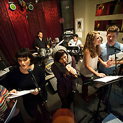 """December 5, 2013 - New York, NY: Members of the NBC musical drama television series """"Smash"""", and their ensemble and band, including, from left, Julia Mattison, Molly Hager, Shannon Ford (drums), Krysta Rodriguez, Dennis Michael Keefe (bass), Monet Julia Sabel, Eric Michael Krop, and Hiroko Taguchi (violin), rehearse at Smash Studios at 36th Street in Manhattan on Thursday afternoon in preparation for their cabaret performance of """"HIT LIST,"""" which will premiere Sun, Dec 8 at 54 Below. CREDIT: Karsten Moran for The New York Times"""