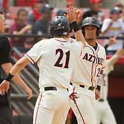15 April 2018: San Diego State infielder Jordan Verdon (21) is congratulated by catcher Dean Nevarez (25) after they score in the bottom of the first giving the Aztecs a 2-0 lead. The San Diego State baseball team closed out the weekend series against Cal State Fullerton with a 9-6 win at Tony Gwynn Stadium. <br /> More game action at sdsuaztecphotos.com