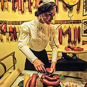 The famous Usinger's woman is preparing sausages in a shop window on The Streets of Old Milwaukee.
