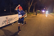 A runner pumps his fist along the course at the Red Bull Wings For Life World Run in Denver, CO, USA on 4 May, 2014. ©Brett Wilhelm