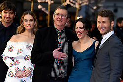 Michiel Huisman (left to right), Lily James, Mike Newell, Jessica Brown Findlay and Glen Powell attending the world premiere of The Guernsey Literary and Potato Peel Pie Society at the Curzon Mayfair, London. Photo credit should read: Doug Peters/EMPICS Entertainment