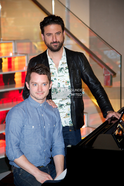 Elijah Wood and Director Eugenio Mira attend 'Grand Piano' photocall at Telefonica Foundation on October 14, 2013 in Madrid, Spain.
