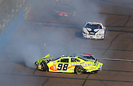 Nov. 14, 2009; Avondale, AZ, USA; NASCAR Nationwide Series driver Paul Menard (98), Jason Bowles (61), and Jeremy Clements (0) crash during the Able Body Labor 200 at Phoenix International Raceway. Mandatory Credit: Jennifer Stewart-US PRESSWIRE
