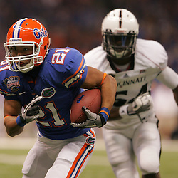 Jan 01, 2010; New Orleans, LA, USA;  Florida Gators running back Emmanuel Moody (21) runs past Cincinnati Bearcats linebacker Walter Stewart (54) for a touchdown during the first half of the 2010 Sugar Bowl at the Louisiana Superdome.  Mandatory Credit: Derick E. Hingle-US PRESSWIRE.