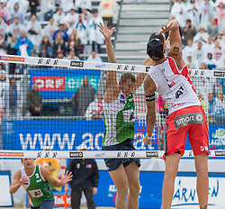 29.07.2015, Strandbad, Klagenfurt, AUT, A1 Beachvolleyball EM 2015, im Bild vorne Clemens Doppler 1 AUT, hinten Aliaksandr Dziadkou 1 BEL / Aliaksandr Kavalenka 2 BEL// during of the A1 Beachvolleyball European Championship at the Strandbad Klagenfurt, Austria on 2015/07/29. EXPA Pictures © 2015, EXPA Pictures © 2015, PhotoCredit: EXPA/ Mag. Gert Steinthaler