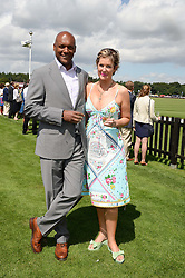 COLIN SALMON and FIONA HAWTHORNE at the Audi International Polo at Guards Polo Windsor Great Park, Egham, Surrey on 28th July 2013.