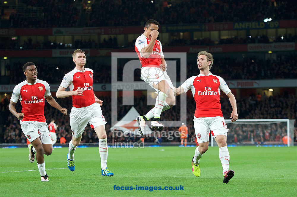 Alexis Sanchez (17) of Arsenal celebrates with (left to right) Alex Iwobi Per Mertesacker and Nacho Monreal after scoring his 2nd goal to make 2-0 during the Barclays Premier League match at the Emirates Stadium, London<br /> Picture by Alan Stanford/Focus Images Ltd +44 7915 056117<br /> 21/04/2016