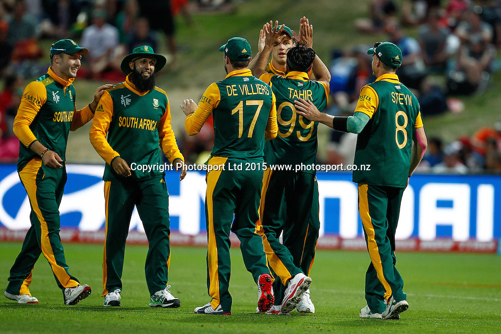 South Africa celebrate a wicket during the ICC Cricket World Cup match - South Africa v Zimbabwe at Seddon Park, Hamilton, New Zealand on Sunday 15 February 2015.  Photo:  Bruce Lim / www.photosport.co.nz