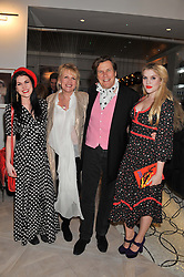 Left to right, COCO FENNELL, LOUISE FENNELL, THEO FENNELL and EMERALD FENNELL at a party to celebrate the publication of Fame Game by Louise Fennell held at Grace, West Halkin Street, London on 12th March 2013.