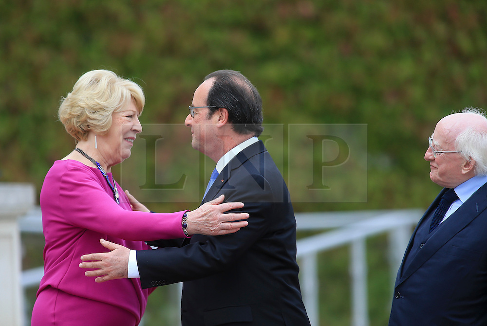© Licensed to London News Pictures. 21/07/2016. Dublin, Ireland.  French President Francois Hollande kisses Sabina Higgins, wife of President Michael D Higgins (right) at the end of a one day visit to Ireland in which he met with Irish President Michael D Higgins and Taoiseach Enda Kennny.  Photo credit: Paul McErlane/LNP