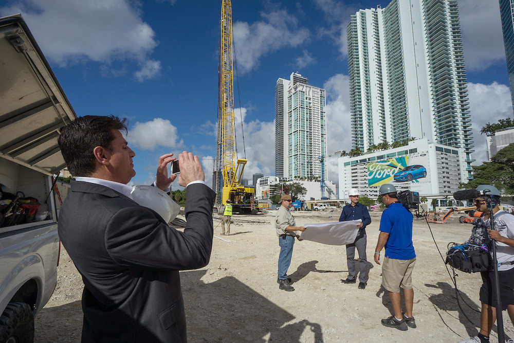 MIAMI,  FLORIDA--- NOVEMBER 3, 2015: <br /> Daniel Kodsi, left, Developer and CEO of Paramount Miami Worldcenter shoots a behind the scenes photo of a video crew on what will become the Paramount Miami Worldcenter in downtown Miami. The 60 story condo tower with 470 residences will sit atop the the Miami Worldcenter Mall. (Photo by Angel Valentin)