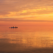 &quot;Life is But a Dream&quot;<br /> <br /> A beautiful and peaceful sunset on Lake Michigan in the Upper Peninsula. The water was smooth as glass as kayakers paddled by heading into the night!