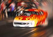 Race car blurring during the race. National Guard drag races 2009 Memphis Motorsports Park.
