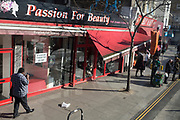 An awning for the beauty bar Passion For Beauty is broken and twisted on the Walworth Road in Southwark, on 25th February 2019, in London, England.