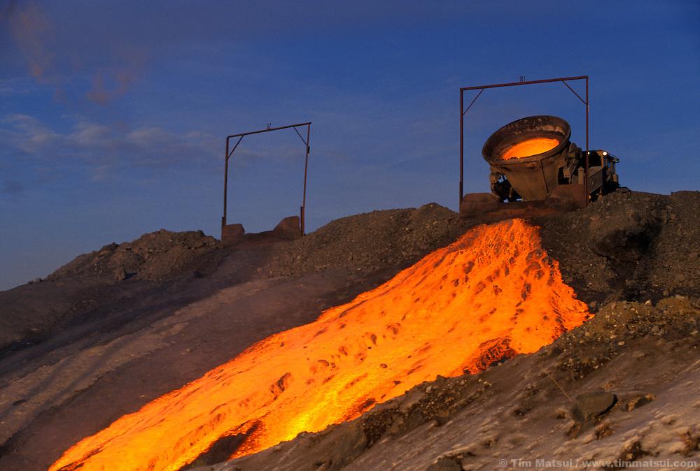 Discarding molten slag.
