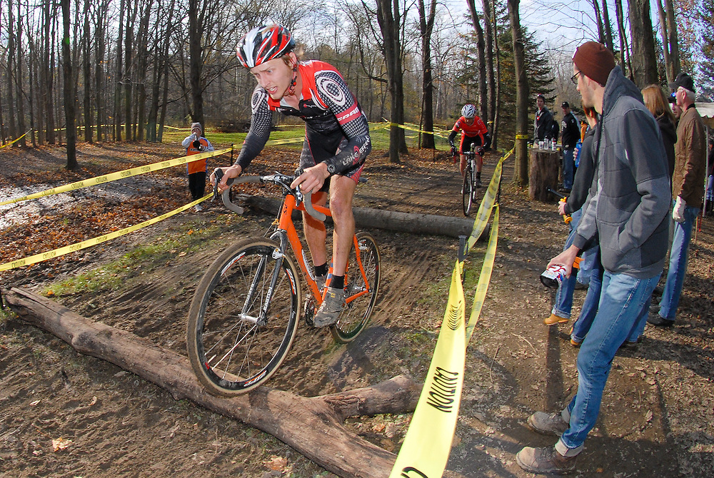 John Proppe bunny hops log barriers at the 2011  Bainbridge, Ohio cyclocross race.