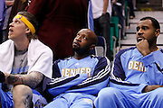 Denver Nuggets players, Chris Anderson, left, Anthony Carter, center, and Malik Allen, right, watch the final seconds of Game 4 of the NBA Western Conference first-round playoff series against the Utah Jazz in Salt Lake City, Sunday, April 25, 2010. The Jazz defeated the Nuggets 117-106.  (AP Photo/Colin E Braley)