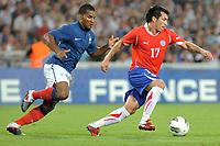 FOOTBALL - FRIENDLY GAME - FRANCE v CHILI - 10/08/2011 - PHOTO SYLVAIN THOMAS / DPPI - GARY MEDEL (CHI) / FLORENT MALOUDA (FRA)