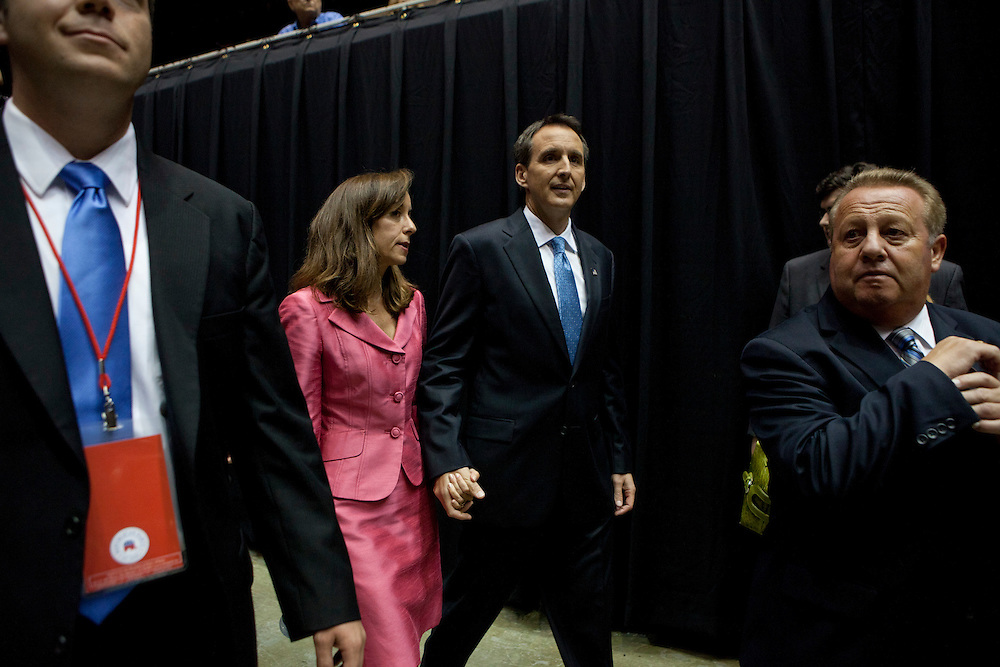 Republican presidential hopeful Tim Pawlenty arrives with his wife Mary Pawlenty in the media area after the Republican presidential debate on Thursday, August 11, 2011 in Ames, IA.