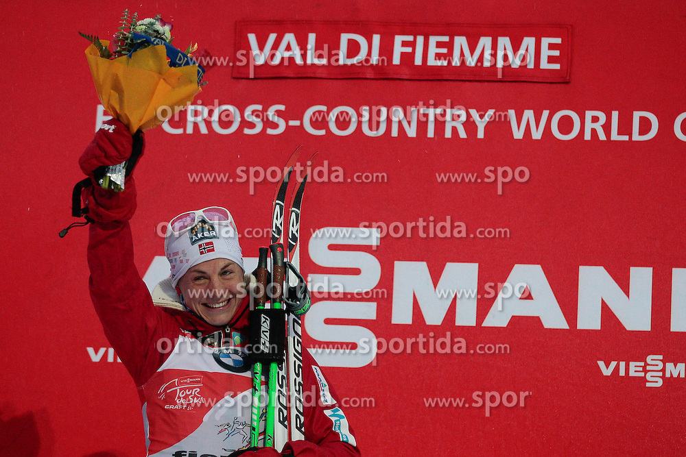 04.01.2014, Langlaufstadion, Lago di Tesero, ITA, FIS Langlauf Weltcup, Tour de Ski, Langlauf Damen, Individual Start 5Km, Siegerpraesentation, im Bild Jacobsen Astrid (NOR) // celebrate on Podium after the Ladies 5 km Cross Country of the Tour de Ski 2014 of FIS Cross Country World Cup at the Cross Country Stadium, Lago di Tesero, Italy on 2014/01/04. EXPA Pictures © 2014, PhotoCredit: EXPA/ Federico Modica