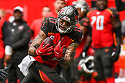 Tampa Bay Buccaneers Wide Receiver Mike Evans (13) takes a catch during the International Series match between Tampa Bay Buccaneers and Carolina Panthers at Tottenham Hotspur Stadium, London, United Kingdom on 13 October 2019.
