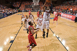 Virginia forward Jamil Tucker (12) comes down with a rebound against Maryland.  The Virginia Cavaliers defeated the Maryland Terrapins 91-76 at the University of Virginia's John Paul Jones Arena  in Charlottesville, VA on March 9, 2008.