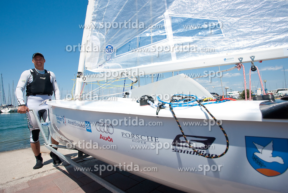 Vasilij Zbogar of Slovenia preparing the boat before practice session on May 19, 2010 near Marina Izola / Marina di Isola, Izola, Slovenia. (Photo by Vid Ponikvar / Sportida)