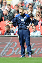 Everton Manager David Moynes shows emotion during the Budweiser FA Cup semi final match between Liverpool and Everton at Wembley on Saturday 14 April 2012 (Photo by Rob Munro)