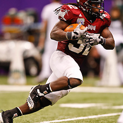 December 18, 2010; New Orleans, LA, USA; Troy Trojans running back DuJuan Harris (32) runs against the Ohio Bobcats during the second half of the 2010 New Orleans Bowl at the Louisiana Superdome. Troy defeated Ohio 48-21. Mandatory Credit: Derick E. Hingle