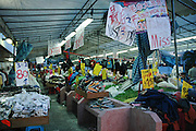 Clothes and more clothes at an open market in Geylang, Singapore
