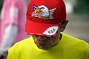 male person wearing a USA flag and eagle cap